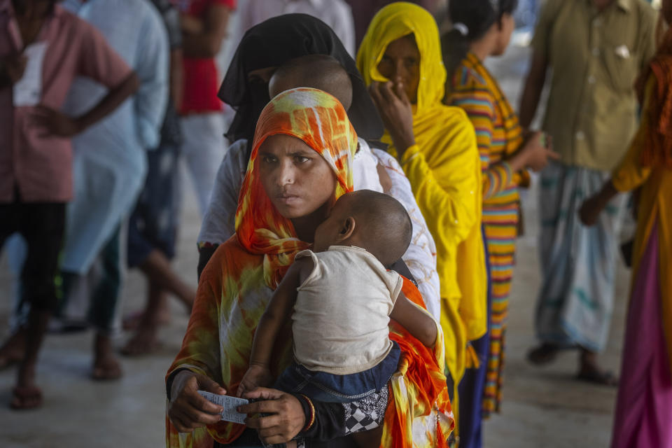Women stand in a queue to receive the vaccine for COVID-19 in Khola Bhuyan village on the outskirts of Gauhati, India, Tuesday, Sept. 7, 2021. (AP Photo/Anupam Nath)