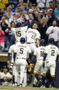 Milwaukee Brewers' Tyrone Taylor(15) gets a high-five from teammate Willy Adames(27) after Taylor's grand slam against the St. Louis Cardinals during the first inning of a baseball game Thursday, Sept. 23, 2021, in Milwaukee. (AP Photo/Jeffrey Phelps)