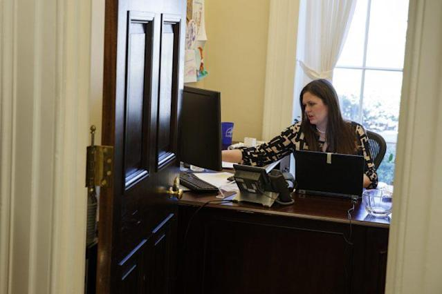 In this March 8, 2017, photo, White House deputy press secretary Sarah Huckabee Sanders works in her office at the White House in Washington. (AP Photo/Evan Vucci)