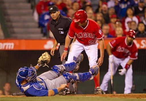 Los Angeles Angels' Peter Bourjos looks at Los Angeles Dodgers catcher A.J. Ellis after being tagged out at home plate during the sixth inning of a spring baseball game, Monday, April 2, 2012, in Anaheim, Calif. (AP Photo/Jeff Lewis)