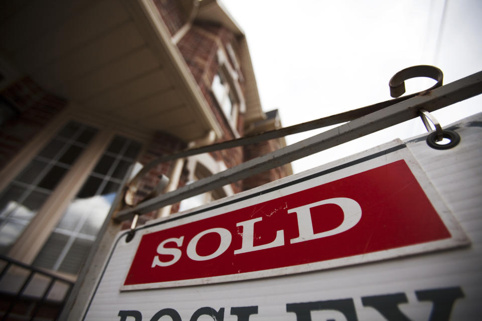 A sign indicating a house has been sold on the real estate market is seen in Toronto