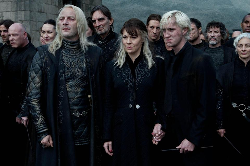 Helen McCrory, centre, as Narcissa Malfoy with Jason Isaacs, left, and Tom Felton, right in Harry Potter and the Deathly Hallows Part 2, 2011 - Hollywood Archive