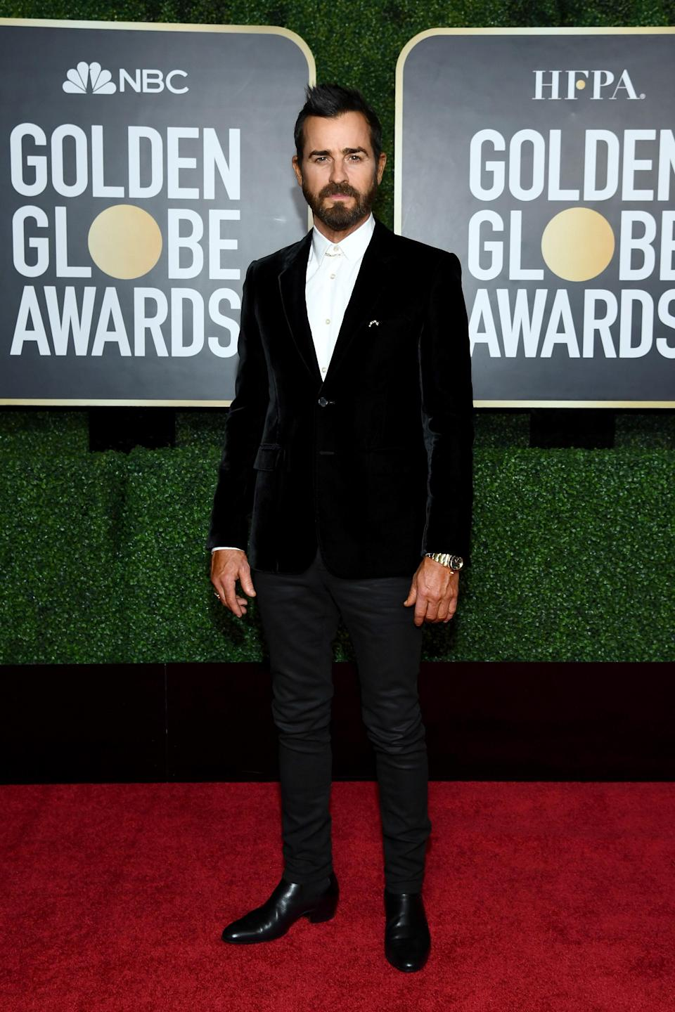 Theroux can't exactly rock his typical leather jacket-and-skinny jeans look to an awards show. A velvet tuxedo jacket and Chelsea boots gets the same idea across nicely, though.
