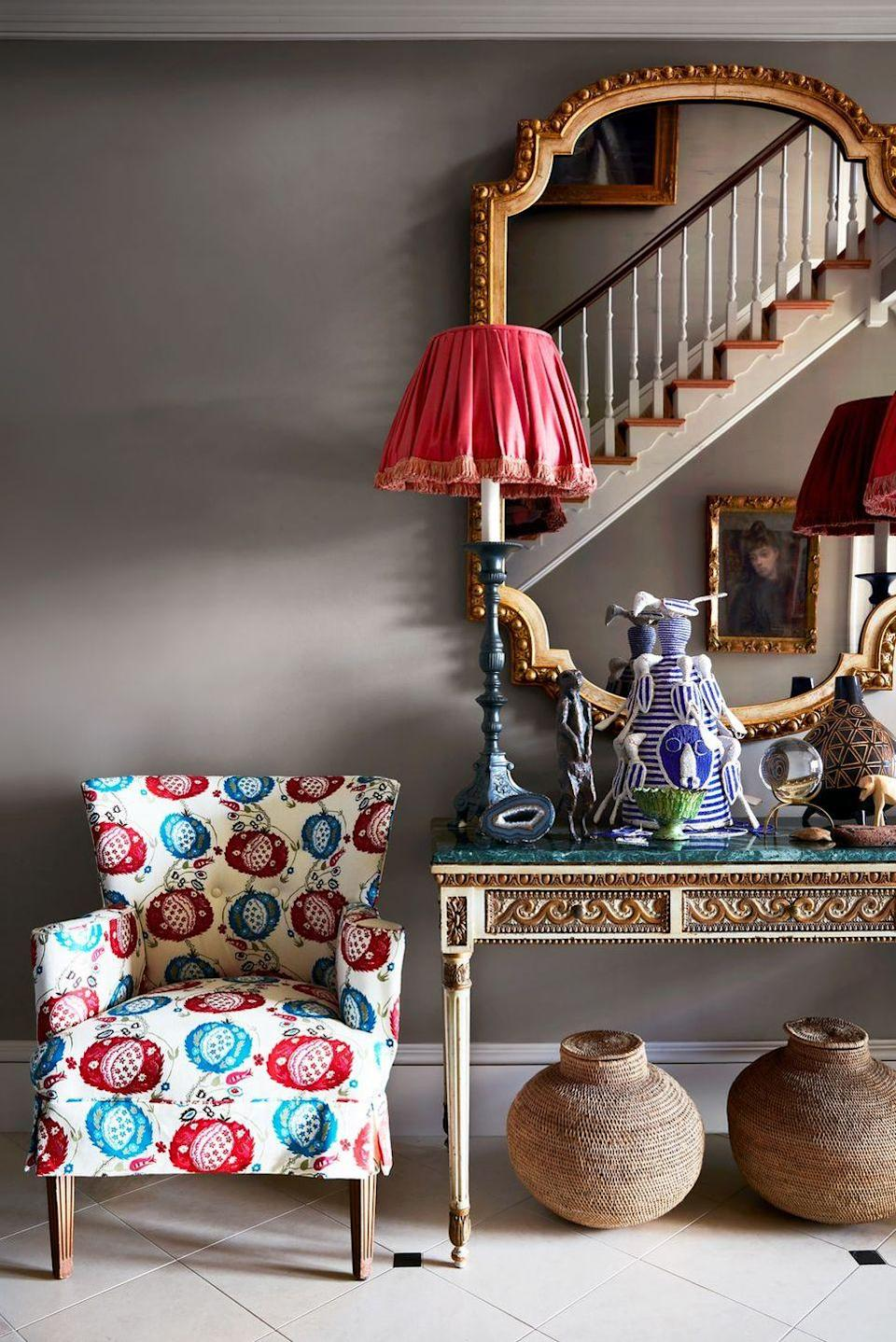 "<p>The space between a console table and floor can look a little awkward when empty, especially in a super collected and thoughtful space, like this hallway in the home of designer <a href=""https://www.mallyskokdesign.com/"" rel=""nofollow noopener"" target=""_blank"" data-ylk=""slk:Mally Skok"" class=""link rapid-noclick-resp"">Mally Skok</a>. So she decided to fill the gap with two decorative baskets that complement the tabletop antiques while also adding a more casual twist. </p>"