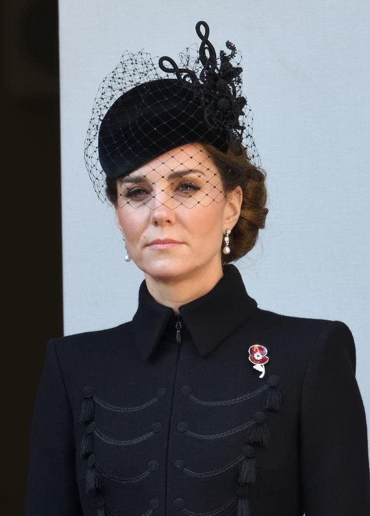 Kate Middleton wears a red poppy pin to honor her grandmother at Cenotaph memorial.