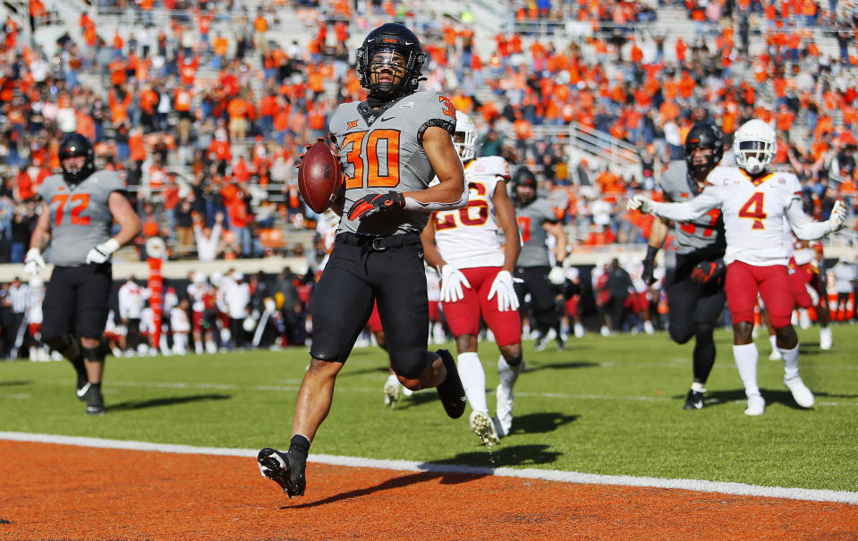 STILLWATER, OK - OCTOBER 24:  Running back Chuba Hubbard #30 of the Oklahoma State Cowboys crosses the goal line after breaking free for a 32-yard touchdown against the Iowa State Cyclones in the second quarter at Boone Pickens Stadium on October 24, 2020 in Stillwater, Oklahoma.  (Photo by Brian Bahr/Getty Images)