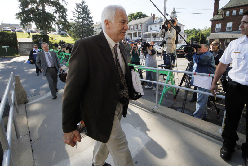 Former Penn State University assistant football coach Jerry Sandusky, center, arrives with his attorney Joe Amendola, left rear, for the second day of jury selection as his trial on 52 counts of child sexual abuse involving 10 boys over a period of 15 years gets underway at the Centre County Courthouse in Bellefonte, Pa., Wednesday, June 6, 2012. (AP Photo/Gene J. Puskar)