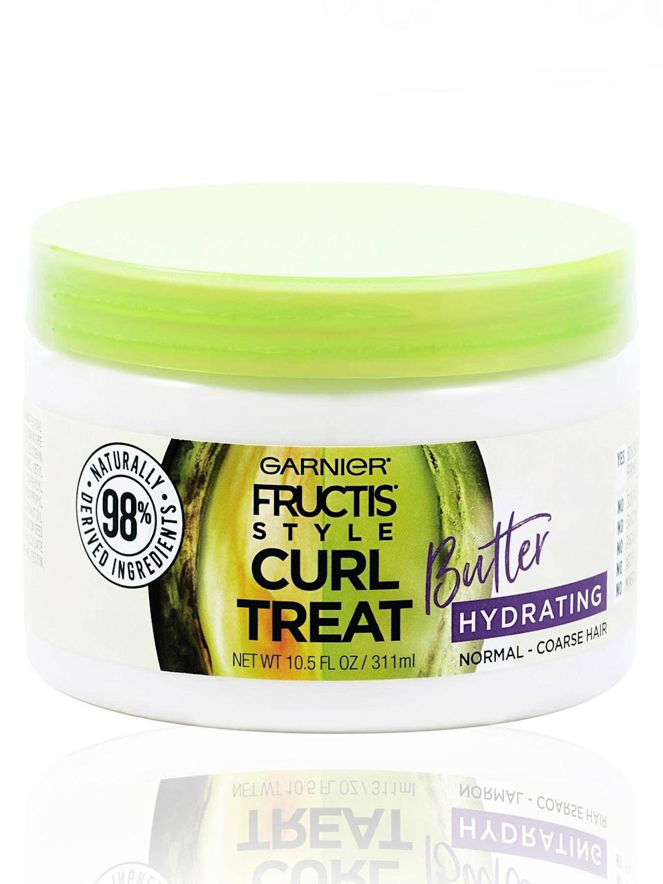 "<p><strong>Garnier</strong></p><p>amazon.com</p><p><strong>$6.99</strong></p><p><a href=""https://www.amazon.com/dp/B07KJ4ZD3C?tag=syn-yahoo-20&ascsubtag=%5Bartid%7C10055.g.33834712%5Bsrc%7Cyahoo-us"" rel=""nofollow noopener"" target=""_blank"" data-ylk=""slk:Shop Now"" class=""link rapid-noclick-resp"">Shop Now</a></p><p>It's affordably-priced, yet this Garnier curl butter cream is <strong>made from almost 100% naturally-derived ingredients</strong>, including coconut oil and cocoa butter. ""My miracle in a jar,"" an Amazon reviewer enthused. ""It defines my curls while leaving my hair soft and manageable.""</p>"