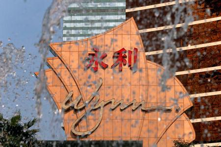FILE PHOTO: A company logo is displayed in front of a fountain at Wynn Macau resort in Macau, China February 8, 2018.  REUTERS/Bobby Yip/File Photo