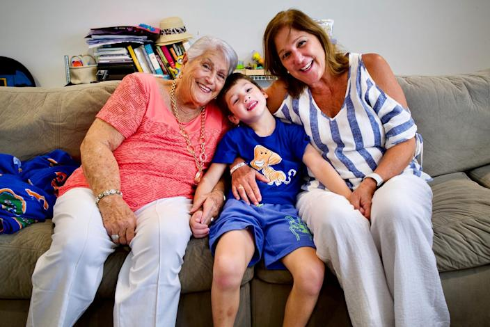 Elena Chavez, 88 (left) and Elena Blasser, 64, (right), pose for a photo with their grandson and great-grandson, John Paul. Chavez and Blesser are still unaccounted for after a 12-story oceanside Miami condo plummeted early Thursday.
