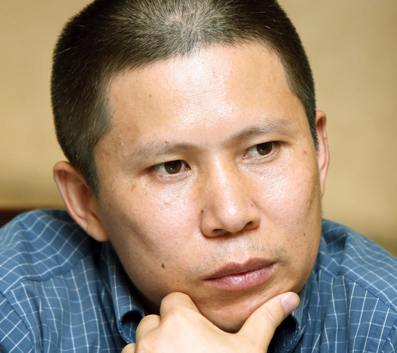 China holds lawyer as crackdown on activism grows