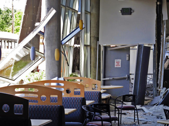 This July 11, 2019 photo shows damage in the first-floor cafeteria at a University of Nevada, Reno dormitory where a July 5 natural gas explosion blew out walls and windows, in Reno, Nev. Argenta Hall and a neighboring dorm will remain closed all school year. With less than six weeks to find rooms for about 1,300 students after a July 5 gas explosion shut down their two biggest residence halls, the university took a lease to turn a Reno casino hotel tower into a college dormitory for a year. (AP Photo/Scott Sonner)