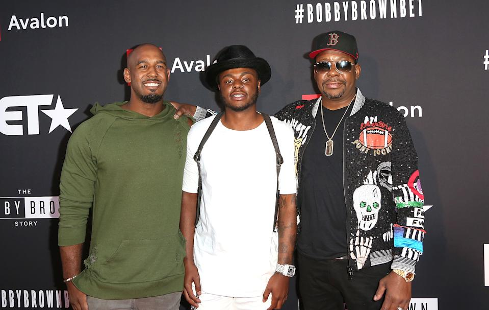"""(L-R) Landon Brown, Bobby Brown Jr., and Bobby Brown arrive at the premiere screening of """"The Bobby Brown Story"""" presented by BET and Totota at Paramount Theater on the Paramount Studios lot on August 29, 2018 in Hollywood, California."""