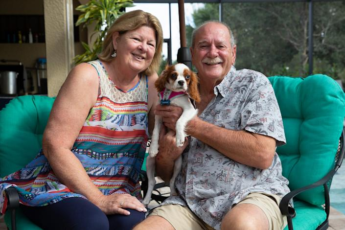 Louise and Richard Wilbanks pose for a portrait with their dog Gunner, Monday, Nov. 23, 2020, at their home in Estero.