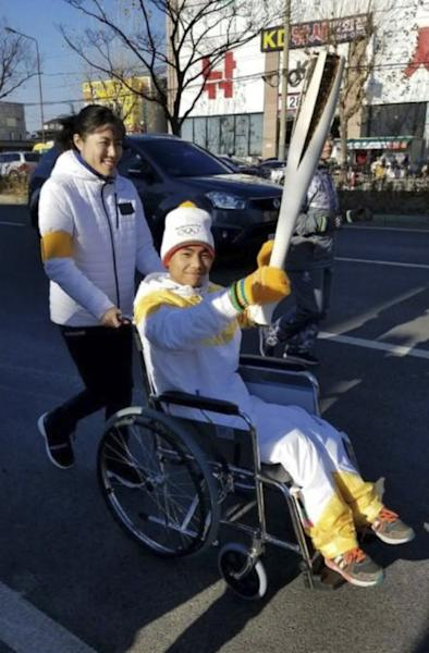 True grit: China's disabled 'handstand' boy takes part in Winter Olympics torch relay