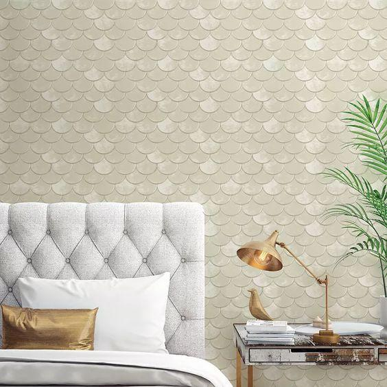 """This textured fish scale pattern has a shimmery finish and it's bringing <em>serious</em> mermaid vibes. Bloomingdale's vast selection of wallpaper has everything from unique prints like this to traditional options to modern brick patterns. $149, Bloomingdale's. <a href=""""https://www.bloomingdales.com/shop/product/tempaper-genevieve-gorder-brass-belly-self-adhesive-removable-wallpaper-double-roll?ID=3588936"""" rel=""""nofollow noopener"""" target=""""_blank"""" data-ylk=""""slk:Get it now!"""" class=""""link rapid-noclick-resp"""">Get it now!</a>"""