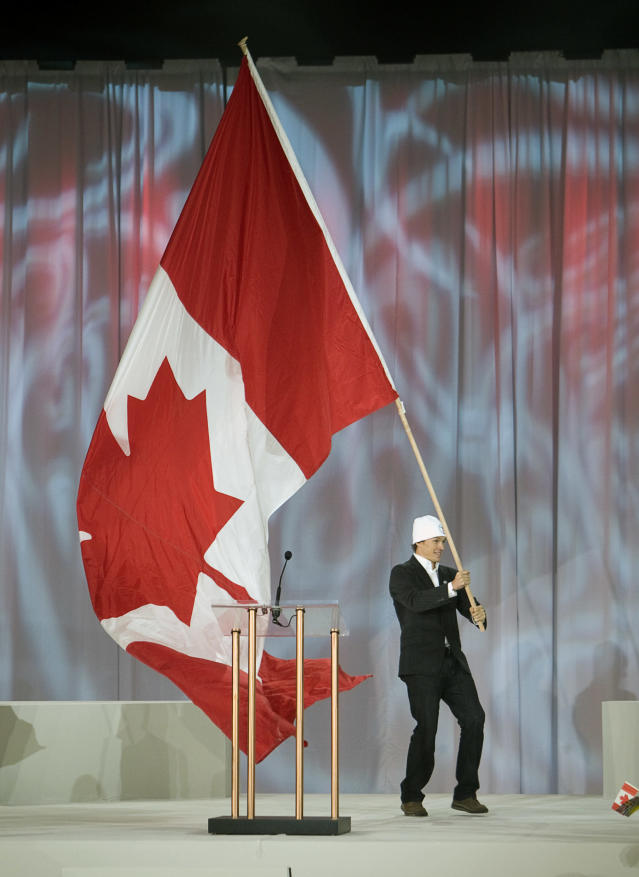 RICHMOND, CANADA - FEBRUARY 12: Simon Whitfield, Olympic gold and silver medalist in the triathlon, waves a Canadian flag during a ceremony for the one year countdown of the 2010 Olympic Games on February 12, 2009 at the Richmond Olympic Oval in Richmond, British Columbia, Canada. (Photo by Jeff Vinnick/Getty Images)