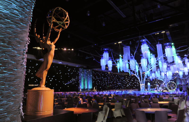 An Emmy statue is placed near the entrance to the Los Angeles Convention Center during the Governors Ball Preview at the 65th Emmy Awards Press Preview Day, on Wednesday, Sept. 18, 2013, in Los Angeles. The 65th Emmy Awards will be held on Sunday at the Nokia Theatre in Los Angeles. (Photo by Chris Pizzello/Invision/AP)