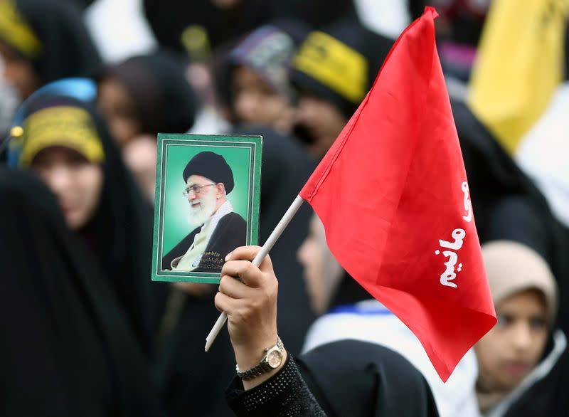 FILE PHOTO: An Iranian protester holds the picture of Iranian Supreme Leader Ayatollah Ali Khamenei as she attends an anti U.S. demonstration, marking the 40th anniversary of the U.S. embassy takeover, near the old U.S. embassy in Tehran