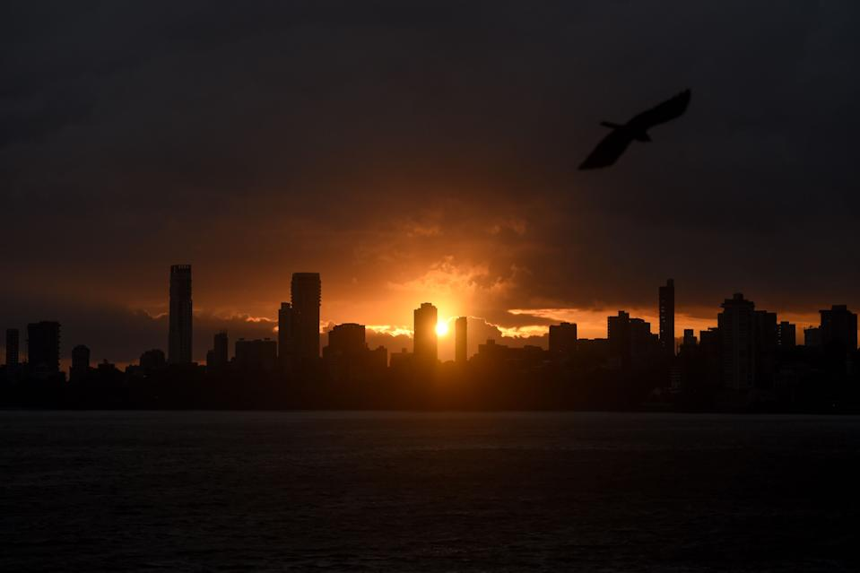 A general view shows clouds lingering over the city's skyline during the sunset in Mumbai on June 3, 2020, as cyclone Nisarga barrels towards India's western coast. - Mumbai authorities shut offices, banned small gatherings and told people to stay home on June 3 as the Indian megacity's first cyclone in more than 70 years approached. Cyclone Nisarga was expected to make landfall near the coastal town of Alibag, around 100 kilometres (60 miles) south of Mumbai, on June 3 afternoon, forecasters said. (Photo by Punit PARANJPE / AFP) (Photo by PUNIT PARANJPE/AFP via Getty Images)