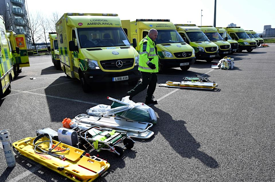Staff prepare to load equipment into London Ambulance Service vehicles in the east car park at the ExCeL London exhibition centre in London on March 28, 2020, that is being transformed into a field hospital to be known as the NHS Nightingale Hospital to help with the novel coronavirus COVID-19 outbreak. - Britain on March 24 said it will open a 4,000-bed field hospital at a London exhibition centre to treat coronavirus cases in the latest measure to tackle the outbreak after the government ordered a nationwide lockdown. (Photo by Glyn KIRK / AFP) (Photo by GLYN KIRK/AFP via Getty Images)