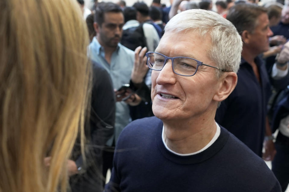 Apple CEO Tim Cook, right, chats with an attendee at the Steve Jobs Theater during an event to announce new products Tuesday, Sept. 10, 2019, in Cupertino, Calif. (AP Photo/Tony Avelar)