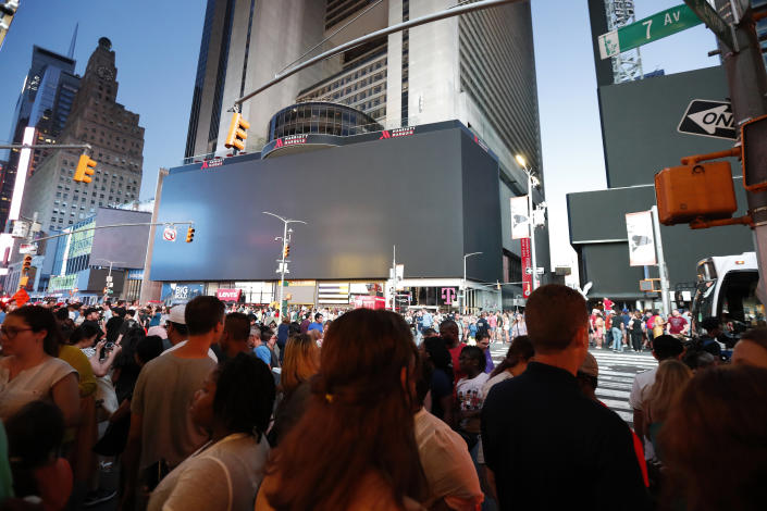 Screens in Times Square are black during a widespread power outage, Saturday, July 13, 2019, in the Manhattan borough of New York. Authorities say a transformer fire caused a power outage in Manhattan and left businesses without electricity, elevators stuck and subway cars stalled. (Photo: Michael Owens/AP)