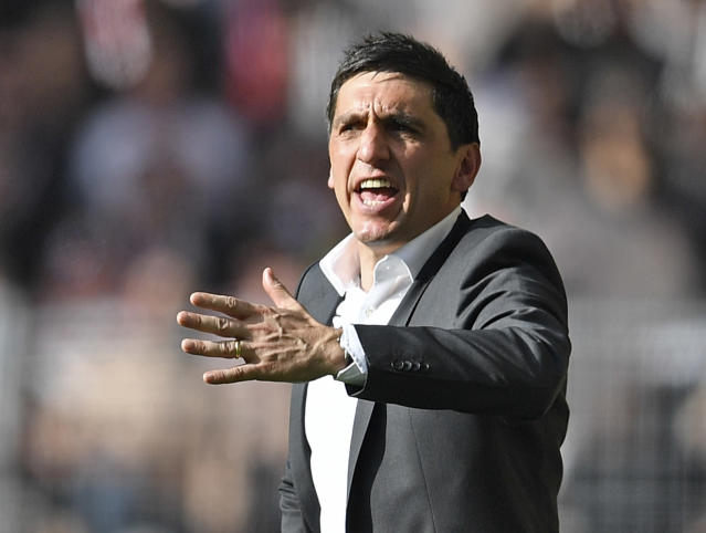 Stuttgart's head coach Tayfun Korkut reacts during the German Bundesliga soccer match between Borussia Dortmund and VfB Stuttgart in Dortmund, Germany, Sunday, April 8, 2018. (AP Photo/Martin Meissner)
