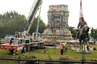 The statue of Confederate General Robert E. Lee being removed in Richmond, Virginia (AFP/POOL)