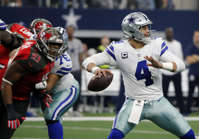 Tampa Bay Buccaneers defensive tackle Gerald McCoy (93) rushes as Dallas Cowboys quarterback Dak Prescott (4) prepares to throw a pass in the second half of an NFL football game in Arlington, Texas, Sunday, Dec. 23, 2018. (AP Photo/Michael Ainsworth)