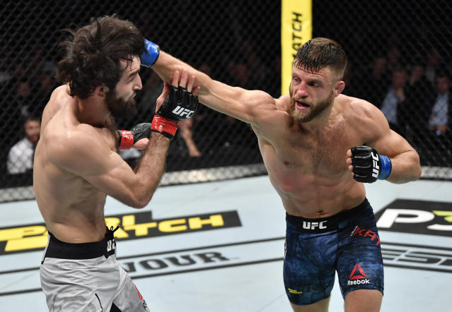 (R-L) Calvin Kattar punches Zabit Magomedsharipov during UFC Moscow on Nov. 9, 2019 in Russia. (Photo by Jeff Bottari/Zuffa LLC via Getty Images)