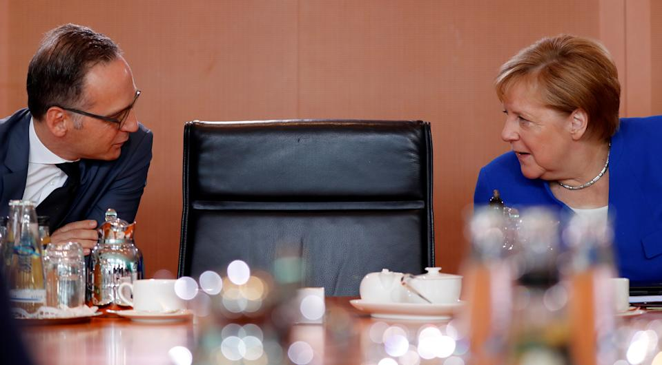 German foreign minister Heiko Maas, left, and chancellor Angela Merkel at a weekly cabinet meeting in Berlin. Photo: Fabrizio Bensch/Reuters