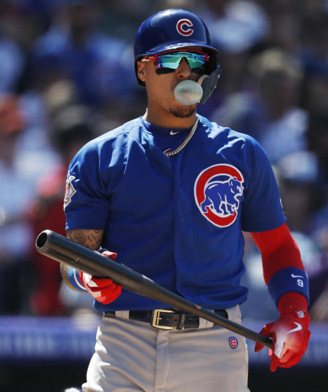Chicago Cubs' Javier Baez blows a gum bubble after striking out against Colorado Rockies relief pitcher Bryan Shaw in the sixth inning of a baseball game Sunday, April 22, 2018, in Denver. (AP Photo/David Zalubowski)