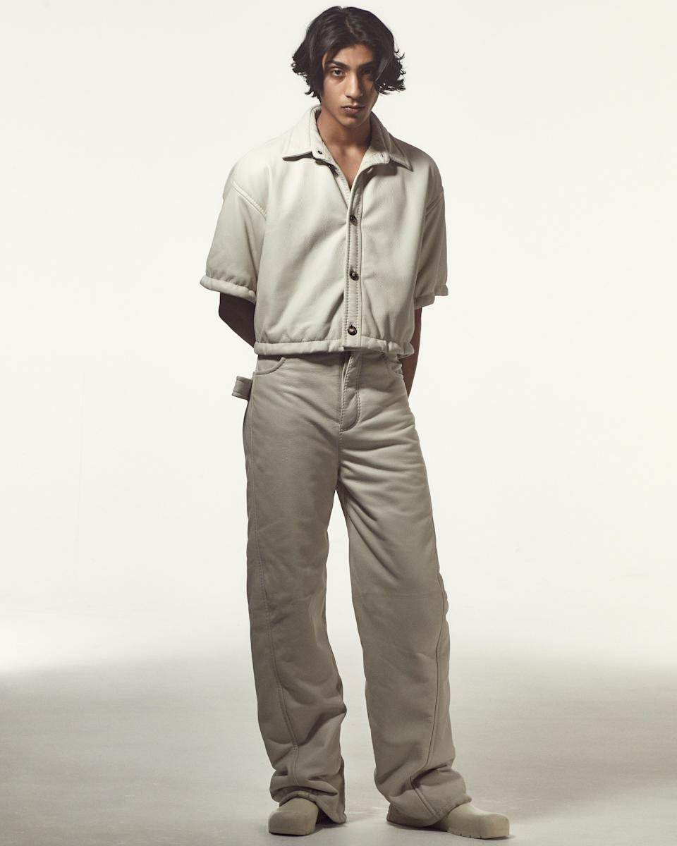 Shirt, $4,300, pants, $5,800, and shoes, $510, by Bottega Veneta.