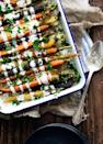 "<p>Getting your veggies in has never been tastier: Just cover them in this creamy tahini dressing.</p><p><strong>Get the recipe at <a href=""https://bromabakery.com/cumin-roasted-carrots-tahini-dressing/"" rel=""nofollow noopener"" target=""_blank"" data-ylk=""slk:Broma Bakery"" class=""link rapid-noclick-resp"">Broma Bakery</a>.</strong></p><p><strong><a class=""link rapid-noclick-resp"" href=""https://go.redirectingat.com?id=74968X1596630&url=https%3A%2F%2Fwww.walmart.com%2Fbrowse%2Fhome%2Fserving-platters-trays%2F4044_623679_639999_2347672_7413764%3Ffacet%3Dbrand%253AThe%2BPioneer%2BWoman&sref=https%3A%2F%2Fwww.thepioneerwoman.com%2Ffood-cooking%2Fmeals-menus%2Fg33251890%2Fbest-thanksgiving-sides%2F"" rel=""nofollow noopener"" target=""_blank"" data-ylk=""slk:SHOP SERVING PLATTERS"">SHOP SERVING PLATTERS</a><br></strong></p>"