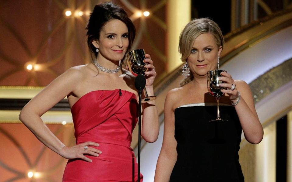 Tina Fey and Amy Poehler hosting the 2014 Golden Globes - Getty