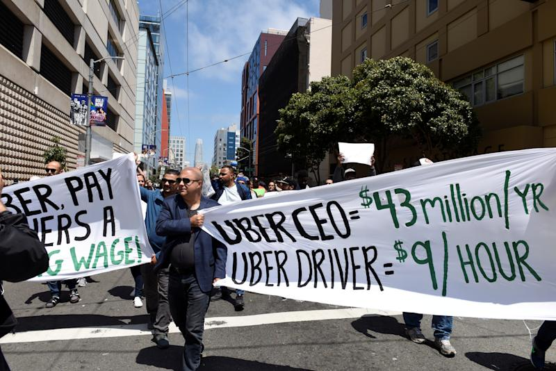 Protestors march through the financial district, demanding fair wages and more transparency during a strike against Uber in San Francisco, California, U.S., May 8, 2019. REUTERS/Kate Munsch