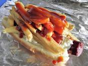 "<p><strong>Polish Boy</strong></p><p>No, it's not a po' boy. A Polish Boy is a kielbasa sandwich layered with fries, either barbecue or hot sauce and coleslaw. While it's reminiscent of a hot dog, Ohio tradition always referred to it as a sandwich. <a href=""https://www.setispolishboys.biz/"" rel=""nofollow noopener"" target=""_blank"" data-ylk=""slk:Seti's"" class=""link rapid-noclick-resp"">Seti's</a> in Cleveland is a hot commodity from their food truck where you can even add chili or cheese.</p>"