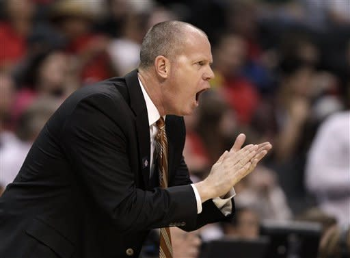 Colorado head coach Tad Boyle directs his team during the first half of an NCAA college basketball game against California in the semifinals of the Pac-12 conference championship in Los Angeles, Friday, March 9, 2012. (AP Photo/Jae C. Hong)