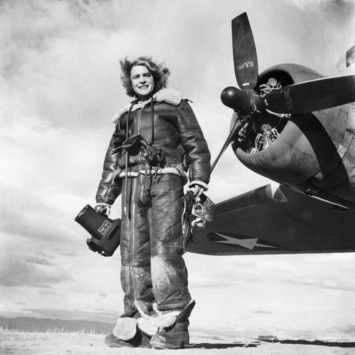 <p>Margaret Bourke-White, fully dressed in a leather, fleece-lined flight suit — camera in hand — stands at the ready by an airplane propeller in this 1943 photo. Bourke-White was the first female photojournalist for LIFE magazine, making some of the most memorable images of the 20th century. She had an amazing career of many firsts and fearless assignments in a traditionally male-dominated line of work. (Photo: Bettmann/Getty Images) </p>