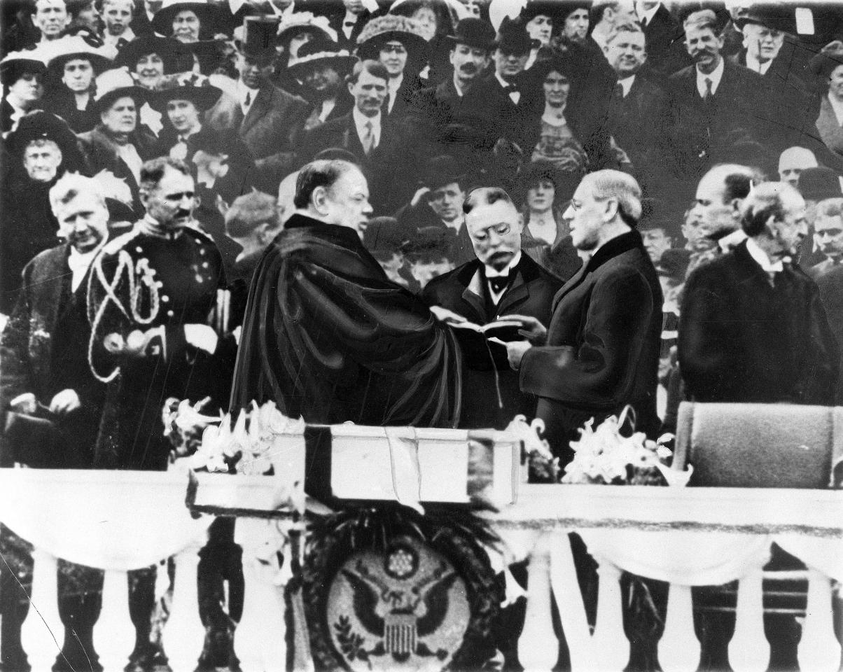 Woodrow Wilson takes the oath of office for his first term of the Presidency on the East Portico at the U.S. Capitol in Washington, D.C., on March 4, 1913.  Chief Justice is Edward D. White.  (AP Photo)