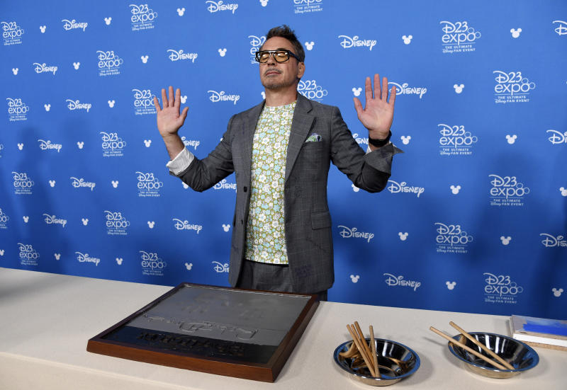 Actor Robert Downey Jr. takes part in his handprint ceremony at the Disney Legends press line during the 2019 D23 Expo, Friday, Aug. 23, 2019, in Anaheim, Calif. (Photo by Chris Pizzello/Invision/AP)