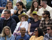 Spectators wearing tennis themed hats sit on Court no. 3 on day two of the Wimbledon Tennis Championships in London, Tuesday June 29, 2021. (AP Photo/Alastair Grant)