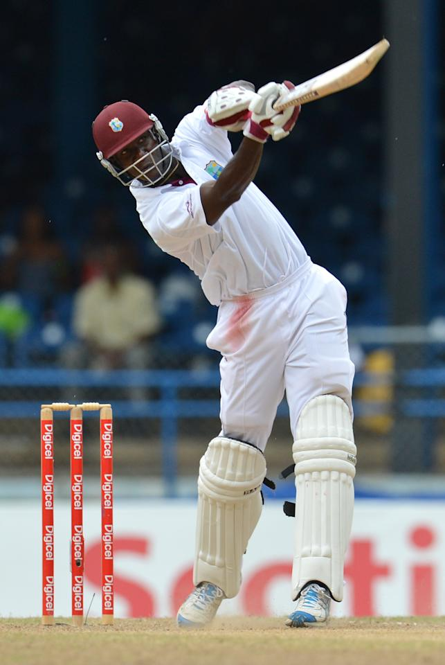 West Indies Darren Sammy launches a six off Australian bowler Ben Hilfenhaus during the final day of the second-of-three Test matches between Australia and West Indies April 19, 2012 at Queen's Park Oval in Port of Spain, Trinidad.