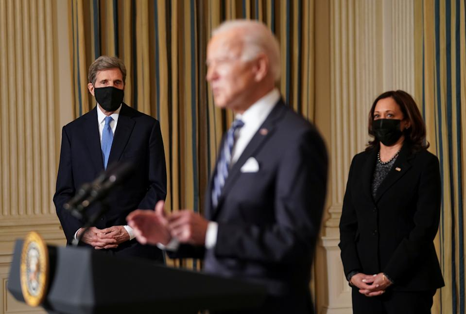 U.S. President Joe Biden delivers remarks on tackling climate change as White House climate envoy John Kerry and Vice President Kamala Harris listen in the State Dining Room at the White House in Washington, U.S., January 27, 2021. REUTERS/Kevin Lamarque