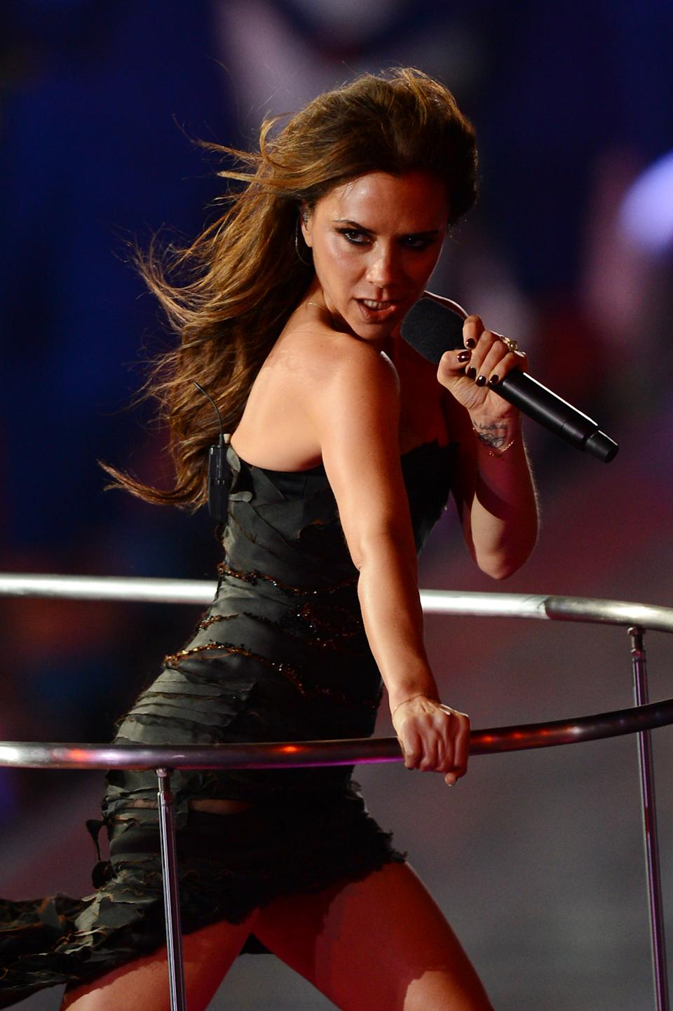 NOW: Victoria Beckham of the Spice Girls performs during the Closing Ceremony on Day 16 of the London 2012 Olympic Games at Olympic Stadium on August 12, 2012 in London, England. (Photo by Mike Hewitt/Getty Images)