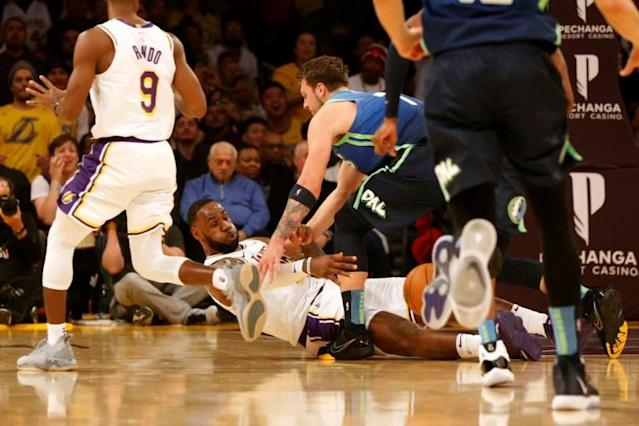 Los Angeles Lakers LeBron James passes the ball as Dallas Mavericks Luka Doncic defends during the first half of the Mavericks 114-100 victory at Staples Center arena (AFP Photo/Katharine Lotze)