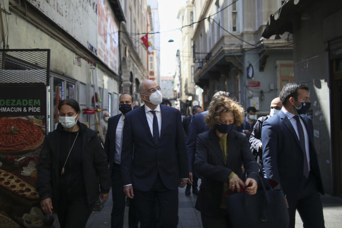Greek Foreign Minister Nikos Dendias, centre, walks to visit an old Greek school after a meeting with Ecumenical Patriarch Bartholomew I, the spiritual leader of the world's Orthodox Christians, at the Greece's consulate in Istanbul, Wednesday, April 14, 2021. Dendias is in Turkey for talks with Turkish Foreign Minister Mevlut Cavusoglu in Ankara on Thursday. (AP Photo/Emrah Gurel)