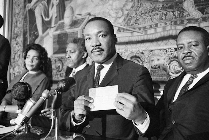 <p>Martin Luther King with the check for 273,000 Swedish crownes in Norway, Dec. 11, 1964. (AP Photo) </p>