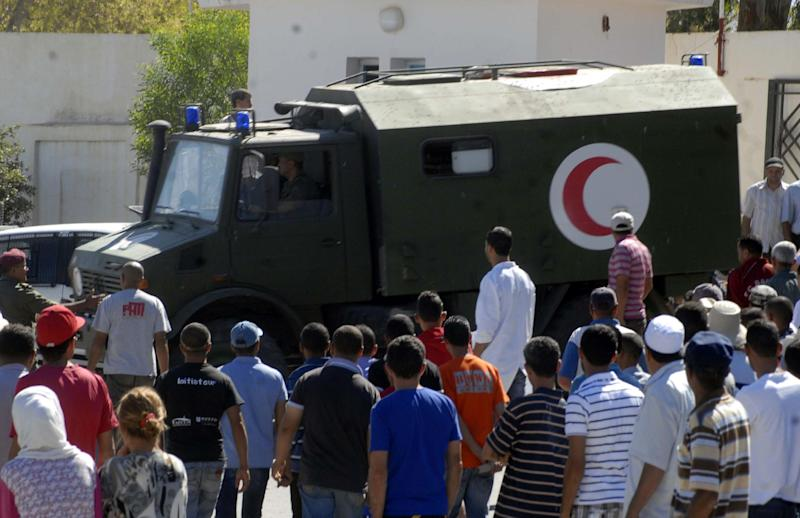 An Army ambulance carrying Tunisian soldiers, injured following an attack near the Algerian border, arrives at a hospital in Kasserine on July 17, 2014